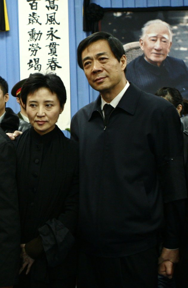 File photo of China's former Chongqing Municipality Communist Party Secretary Bo and his wife posing for group photos at a mourning in Beijing