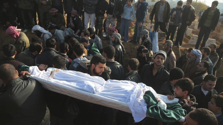 People carry the body of one of the five civilian activists, who were killed during what activists said was an ambush, during their funeral in eastern al-Ghouta