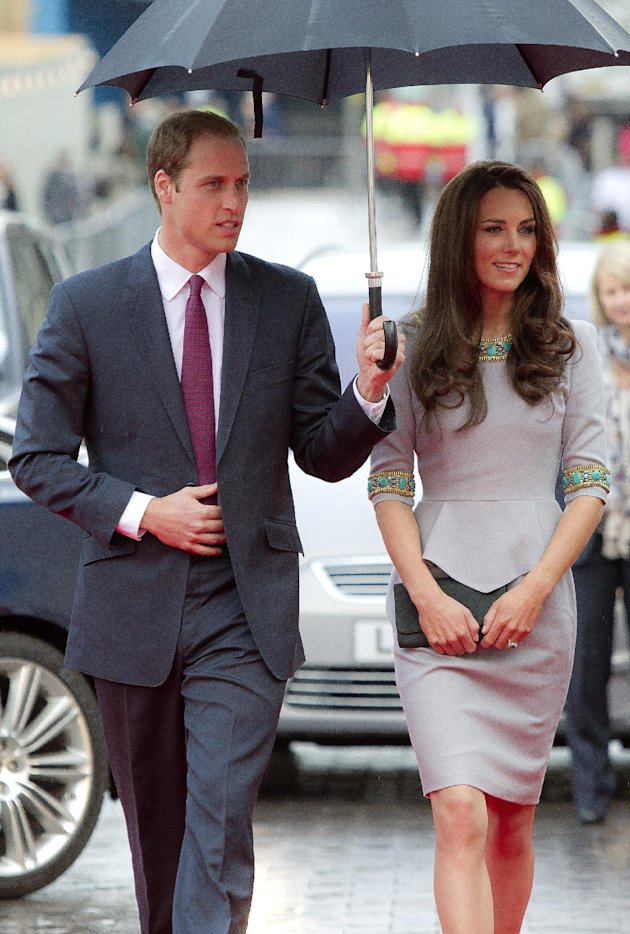 The Duke and Duchess of Cambridge arrive under an umbrella for the UK Premiere of 'African Cats', in aid of 'Tusk Trust', at the BFI Southbank  in central London, Wednesday, April 25, 2012. (AP Photo/