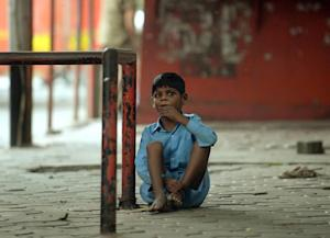 Nine year old Indian boy Lakhan Kale is tied with a …