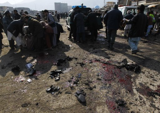 People help clear casualties from the site of a suicide attack at a Shi'ite Muslim gathering in Kabul