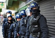 "Metropolitan Police officers prepare to carry out a raid on a property on the Churchill Gardens estate in Pimlico, London during an operation where police hope to recover property stolen during the recent disturbances in the capital Thursday Aug. 11, 2011. British Prime Minister David Cameron says the government is ""acting decisively"" to restore order after riots that shocked the country. Cameron told lawmakers that ""we will not allow a culture of fear to exist on our streets."" (AP Photo/Anthony Devlin/PA Wire) UNITED KINGDOM OUT"