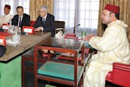 Moroccan King Mohammed VI (R) heads a cabinet meeting at the Royal Palace in Rabat. The king outlined curbs to his wide political powers in proposed constitutional reforms and pledged to build a constitutional monarchy with a democratic parliament