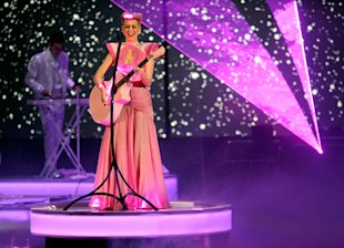 Singer Katy Perry performs onstage at the 2011 American Music Awards