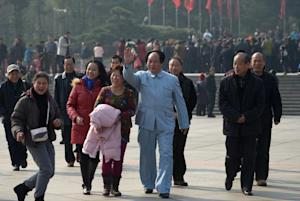 An actor (centre) playing China's former leader …