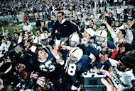 FILE - In this Jan. 2, 1987 file photo, Penn State coach Joe Paterno is carried off after defeating Miami, 14-10, in the Fiesta Bowl NCAA college football game to win the national championship, in Tempe, Ariz. On Sunday, Jan. 22, 2012, family says Paterno, winningest coach in major college football, has died. (AP Photo/Jim Gerberich, File)