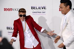 Justin Bieber (L) and director Jon M. Chu at the world …