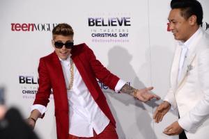 Justin Bieber (L) and director Jon M. Chu at the world…