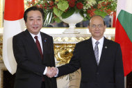 Japan's Prime Minister Yoshihiko Noda, left, greets Myanmar's President Thein Sein before their summit talks held on the sidelines of the Mekong-Japan Summit at the State Guest House in Tokyo on Saturday, April 21, 2012. (AP Photo/Tomohiro Ohsumi, Pool)