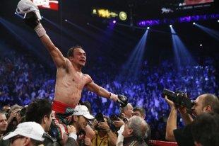 Juan Manuel Marquez celebrates his win over Manny Pacquiao. (AP)