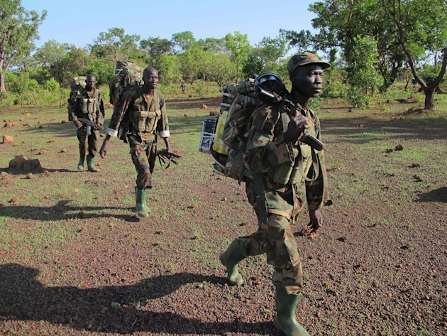 In this photo of  Thursday April 19, 2012 Ugandan soldiers hunting for fugitive warlord Joseph Kony deep in the Central African Republic jungle patrol the area. For Ugandan soldiers tasked with catchi