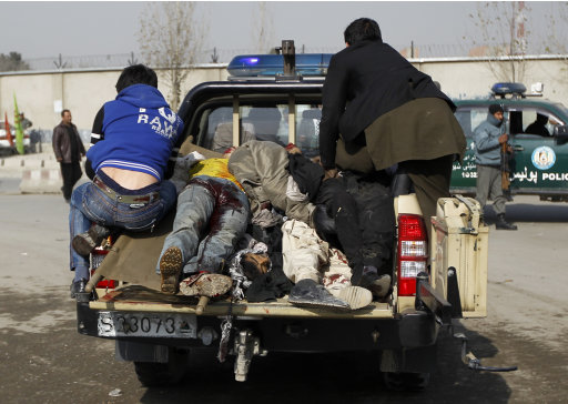 Casualties are transported away after a suicide attack at a Shi'ite Muslim gathering in Kabul