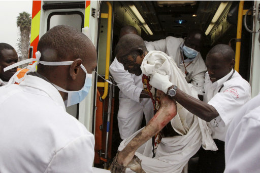 A person injured in a gasoline pipeline incident is brought to Kenyatta National Hospital in Nairobi, Kenya, Monday, Sept. 12, 2011. A local official says at least 61 bodies have been recovered after an explosion of a gasoline pipeline running through a slum in Kenya's capital. (AP Photo/Khalil Senosi)