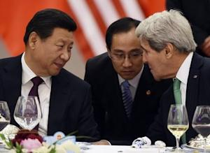 Chinese President Xi Jinping speaks with U.S. State Secretary John Kerry, through a translator, during a lunch banquet in the Great Hall of the People in Beijing