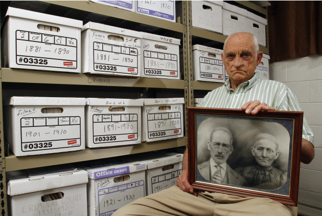 Jack Goins poses with a photo dated to have been taken in 1898 of his step-great-great grandfather George Washington Goins, who died in 1817, left, and great-great grandmother, Susan Minor-Goins who d
