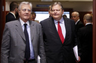 European Central Bank President Jean-Claude Trichet, left, enters the room with Greek Finance Minister Evangelos Venizelos prior to signing a copy of the 'European Stability Mechanism' on the sidelines of a meeting of eurozone finance ministers at the EU Council building in Brussels on Monday, July 11, 2011. European officials are trying to work out a strategy Monday to prevent the eurozone's debt crisis from spilling over into bigger economies such as Italy and Spain, as they discuss details of a second bailout for Greece. (AP Photo/Virginia Mayo)
