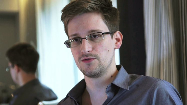 NSA whistleblower Snowden, an analyst with a U.S. defence contractor, is interviewed by The Guardian in his hotel room in Hong Kong