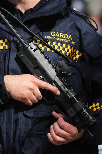 Armed gardai opened fire on a car carrying suspected members of a crime gang
