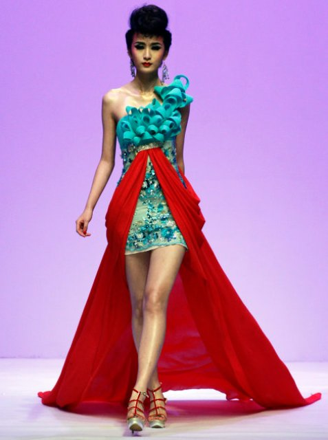 A Chinese model wears a creation of Taiwanese designer Tsai Meiyue during a fashion show in Beijing, China, Sunday, Oct. 30, 2011. (AP Photo/Ng Han Guan)