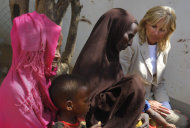 In this photograph taken during an official White House organized visit, Jill Biden, wife of U.S. Vice President Joe Biden, sits with Somali refugees during a photo opportunity at a UNHCR screening center on the outskirts of Ifo camp outside Dadaab, eastern Kenya, 100 kms (60 miles) from the Somali border, Monday Aug. 8, 2011. (AP Photo/Jerome Delay)