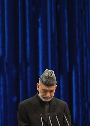 Afghan President Hamid Karzai addresses the loya Jirga, …