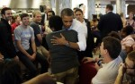 U.S. President Obama receives a hug during a visit to Sloopy's diner at the Ohio State University in Cleveland