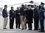 President Barack Obama is hugged by New York Gov. Andrew Cuomo upon his arrival at JFK International Airport in New York, Thursday, Nov. 15, 2012, en route to visit areas devastated by Superstorm ...