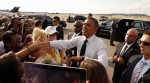U.S. President Obama greets supporters upon his arrival in Tampa