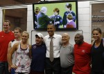 U.S. President Obama poses for a picture with U.S. athletes and their staff during his visit to the U.S. Olympic Training Facility in Colorado Springs
