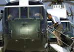 President Barack Obama boards Marine One helicopter as he departs Andrews Air Force Base, Md., for Camp David, Saturday, Aug. 4, 2012. President Obama celebrated his 51st birthday Saturday with a ...