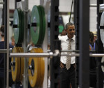 U.S. President Obama is reflected in a mirror among heavy weights as he visits the U.S. Olympic Training Facility in Colorado Springs