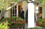 U.S. President Obama departs the Oval Office of the White House in Washington