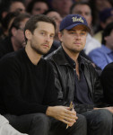 FILE - In this Dec. 22, 2009, file photo, actors Tobey Maguire, left, and Leonardo DiCaprio watch an NBA basketball game between Los Angeles Lakers and the Oklahoma City Thunder in Los Angeles ...
