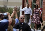 U.S. President Barack Obama and first lady Michelle Obama waves as they arrive to speak in Dubuque, Iowa