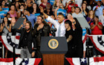 President Barack Obama, center, appears with the musical group Mana at campaign event at Desert Pines High School on Sunday, Sept. 30, 2012 in Las Vegas. Obama is spending three days in Henderson ...
