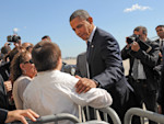President Barack Obama greets 13-year-old Joshua Alvarez from Nassau County as he arrives at JFK International Airport in New York, Monday, Sept. 24, 2012. (AP Photo/ Louis Lanzano)