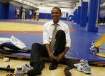 U.S. President Obama puts on his shoes as he visits the U.S. Olympic Training Facility in Colorado Springs