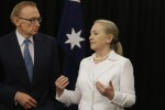 U.S. Secretary of State Hillary Clinton and Australian Foreign Minister Bob Carr talk as they pose for photographs in Perth