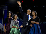 President Barack Obama waves as he walks on stage with first lady Michelle Obama and daughters Malia and Sasha at his election night party Wednesday, Nov. 7, 2012, in Chicago. Obama defeated ...