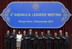 U.S. President Barack Obama, fifth from left, stands hand in hand with ASEAN leaders for a family photo during the ASEAN-U.S. leaders' meeting at the Peace Palace in Phnom Penh, Cambodia, Monday ...