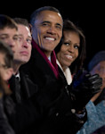 President Barack Obama and first Lady Michelle Obama look to the stage during the National Christmas Tree Lighting on the Ellipse, Thursday, Dec. 6, 2012, in Washington. This year's giant blue ...