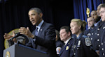 President Barack Obama, accompanied by first responders behind him, gestures as he speaks in the South Court Auditorium of the Eisenhower Executive Office building on the White House complex in ...