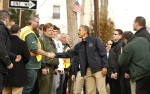 U.S. President Obama shakes hands during visit to a hurricane battered Staten Island neighborhood in New York