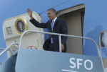 President Barack Obama waves from the top of the steps of Air Force One at San Francisco International Airport in San Francisco, Wednesday, April 3, 2013. Obama will be attending Democratic ...