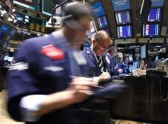 Traders work on the floor of the New York Stock Exchange, May 5, 2010. REUTERS/Brendan McDermid