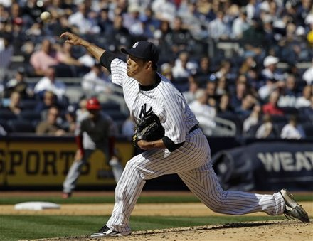 New York Yankees Starting Pitcher Hiroki Kuroda, Of Japan,  Delivers In The Seventh-inning Against The Los Angeles