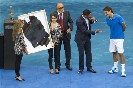 Roger Federer From Switzerland, Right, Receives A Black Suit From U.S. Actor Will Smith's Last Movie 'Men In Black 3'