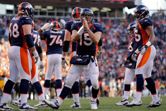 Tim Tebow #15 Of The Denver Broncos Celebrates