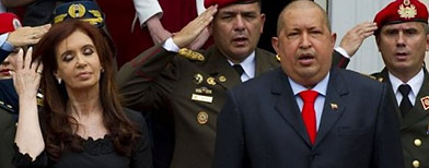 Cristina, junto a su par Hugo Chávez/ AFP