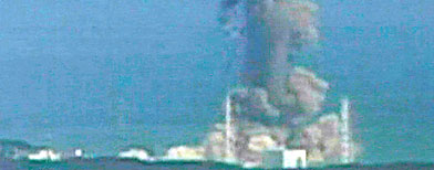 In this image made off Japan's NTV/NNN Japan television footage, smoke ascends from the Fukushima Dai-ichi nuclear plant's Unit   3. (AP/NTV/NNN Japan)